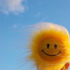 Smiley Face Sunflowers On Blue Sky Mobile Wallpaper