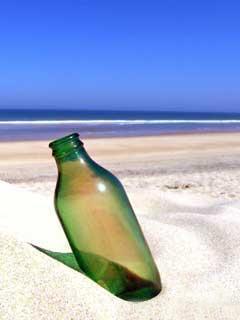 Bottle In Sand Mobile Wallpaper