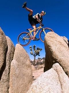 Man Jumping On Stones Mobile Wallpaper